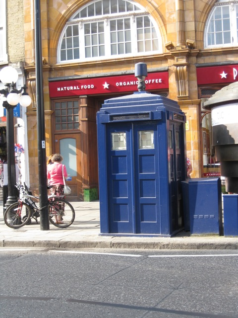 Sadly not a time machine. Outside Earl's Court tube station, September, 2014